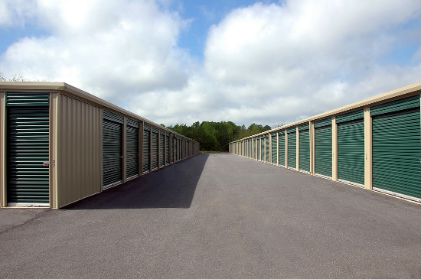 Rows of green self storage units